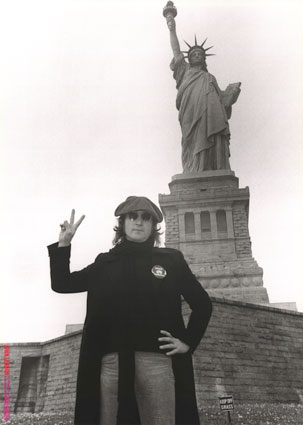 John Lennon at the statue of liberty in New York City